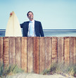 Businessman with Surfboard by the Beach