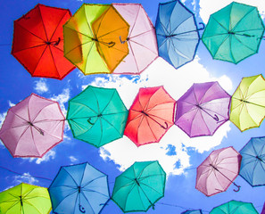 different colorful umbrellas on sky