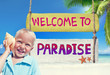 Little Boy Holding a Seashell with Welcome Sign