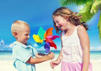 Children Playing with the Pinwheel on a Beach