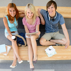 Three college students looking camera top view