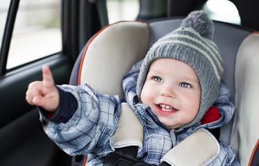 toddler  boy sitting in the car seat
