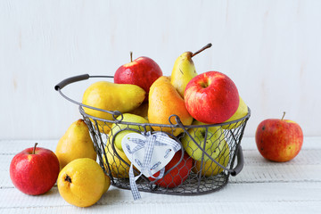 full basket of apples and pears