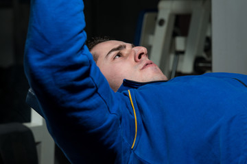 Healthy Young Man Doing Exercise For Chest