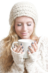 Young woman holding a mug eyes closed