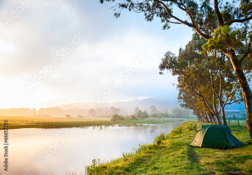 Tuinposter Kamperen Camping by a river