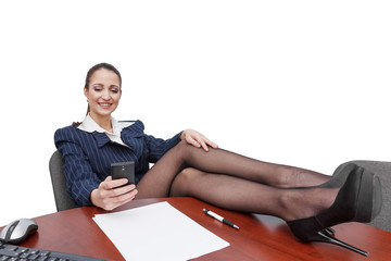 Businesswoman with smartphone sending message