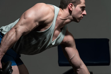 Muscular Men Doing Heavy Weight Exercise For Triceps