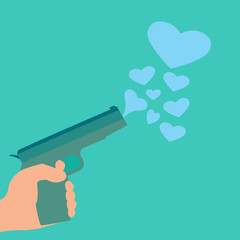 Hand with gun and hearts green