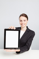 Happy Businesswoman Showing Digital Tablet