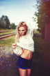 Blonde cute girl fashion look. Photo in the summer park in day l