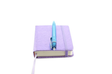 Purple notebook and pen