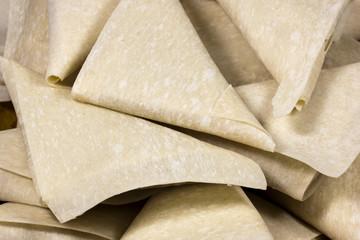 Closeup Stack of Freshly Folded Uncooked Samoosas