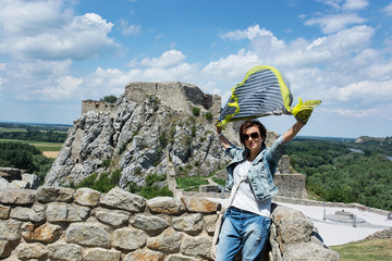 Beautiful woman with fluttering scarf on Devin castle