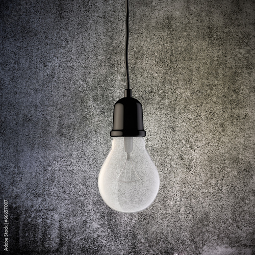 3d light bulb on vintage concrete wall