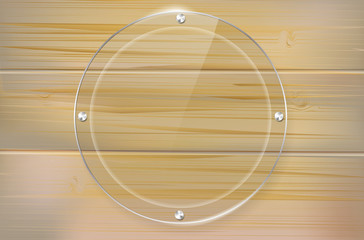 Transparent glass circle frame on wooden background