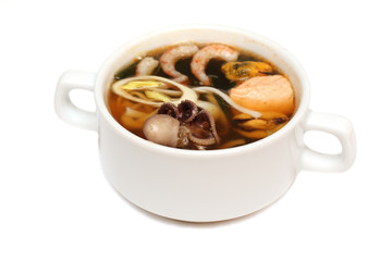 Asian cuisine, soup with octopus, crab, shrimp, fish and mussels