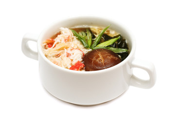 Asian soup with crab meat and mushrooms