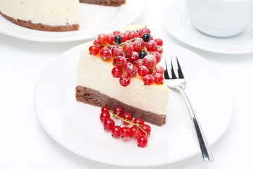 piece of cheesecake with red and black currants and coffee