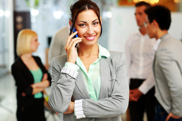 Happy businesswoman talking on the smartphone