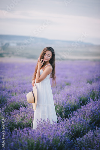 Beautiful young woman posing in a lavender field - 66659274