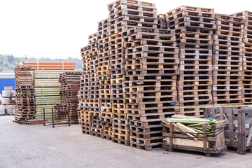 Stacks of old wooden pallets in a yard