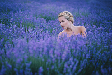 Beautiful young girl posing in a lavender field