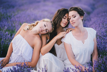 Three women posing in a lavender field