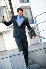 Smiling businessman walking down stairs