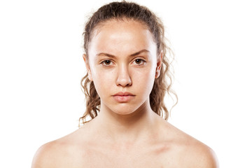 serious young girl without makeup with a lifted eyebrow