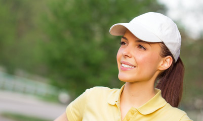 Profile of a smiling young sports woman