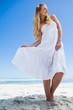 Pretty carefree blonde posing on the beach