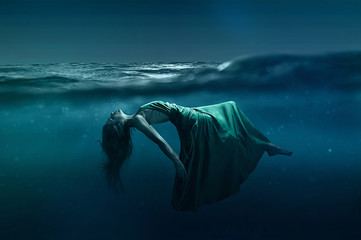 Woman floating underwater