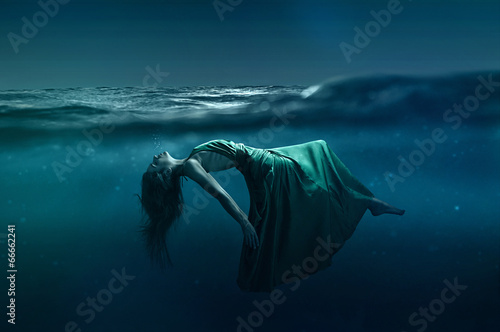 canvas print picture Woman floating underwater