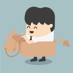 businessman riding the toy horse