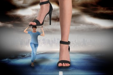 Composite image of female feet in black sandals stepping on girl