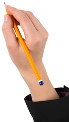 Businesswomans hand writing with pencil