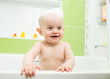 happy baby boy taking bath