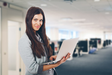 Businesswoman with Laptop at Office