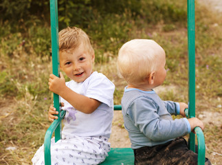 two little cute boy playing