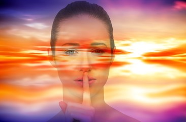Composite image of beautiful brunette making quiet gesture