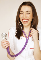 young pretty woman doctor with stethoscope