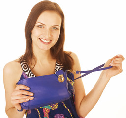 young pretty woman in studio with little purse