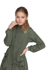 Pensive preteen girl in the jacket
