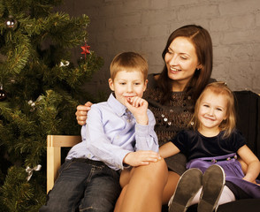 happy family at christmas tree