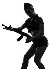 sexy woman in army uniform holding kalachnikov silhouette
