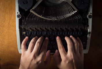 Human hands typing with typewriter.