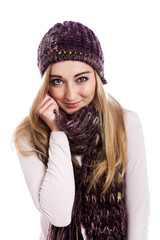 Beautiful female model wearing beanie and scarf