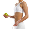 young athletic woman holding a green apple