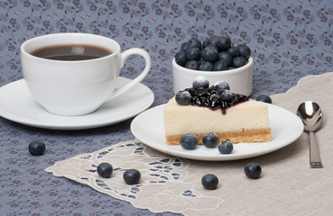 Cheese Cake With Blueberry Jam And Blueberries On White Plate